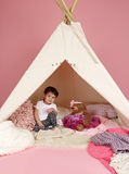 Child Play: Pretend  Games Toys and Teepee Tent Royalty Free Stock Photos