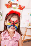 Child in play room with paint of face. Stock Images