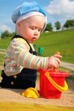 Child play in sandbox royalty free stock photos