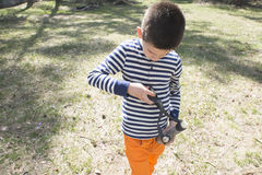 Child play with sling toy Royalty Free Stock Photography