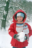 Child play on snow Royalty Free Stock Photography