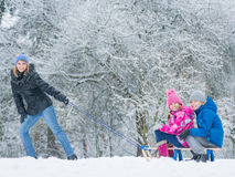 Child play in snow with sled Stock Photos