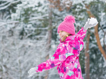 Child play in snow on winter day Stock Photos