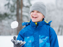Child play in snow on winter day Royalty Free Stock Photos