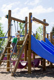 Child on play structure. Child on playground play structure Stock Photo