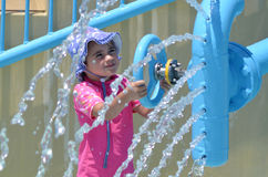 Child play with water fountain in water park Royalty Free Stock Images