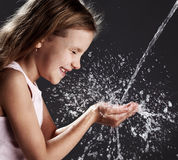 Child play with water Royalty Free Stock Image