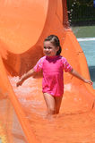Child play with water in water park Stock Image