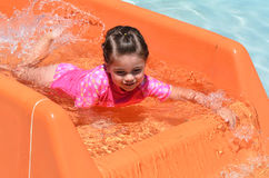 Child play with water in water park Royalty Free Stock Photo