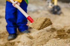 Free Child Play With Sand And Red Shovel Stock Images - 89430794