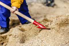 Free Child Play With Sand And Red Shovel Royalty Free Stock Images - 91616009