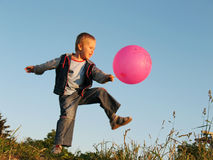 Child play withball. Child play with red ball Royalty Free Stock Photos
