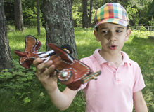 Child play with a wooden plane in the mountain Stock Images
