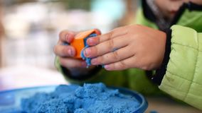 The child is played with kinetic sand. stock footage