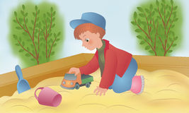 The child is played in a sandbox Stock Image