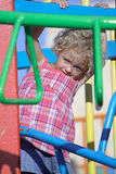 Child on a playground. A caucasian young child being cautious at the playground Royalty Free Stock Photos