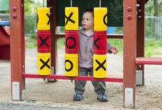 Child in playground royalty free stock photos