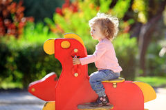 Child on playground. In summer park royalty free stock photography