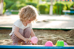 Child on playground. In summer park stock photo
