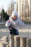 Child on playground. Merry child on playground, springtime Royalty Free Stock Image