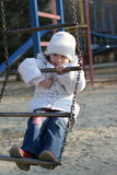 Child on playground. Merry child on playground, springtime Stock Photos
