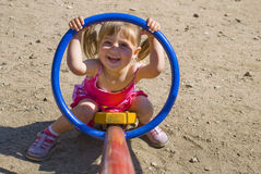 CHILD AT THE PLAYGROUND. Girl playng at the children's playground Royalty Free Stock Photos