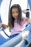 Child at Playground. Image of a child having fun at a playground stock photo