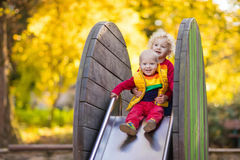 Child on playground in autumn. Kids in fall. Royalty Free Stock Photos