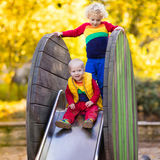 Child on playground in autumn. Kids in fall. Stock Image