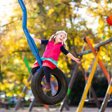 Child on playground in autumn. Kids in fall. Stock Photography