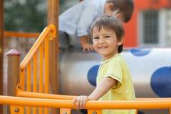 Child on the playground, having fun Stock Photo