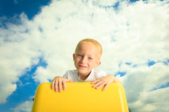 Child in playground kid in action boy play on leisure equipment Stock Image