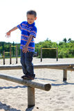 Child in playground, kid in action playing Royalty Free Stock Photo