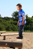 Child in playground, kid in action playing Stock Photography