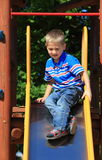 Child in playground, kid in action playing Royalty Free Stock Image