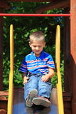 Child in playground, kid in action playing Royalty Free Stock Photos