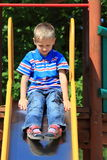 Child in playground, kid in action playing Stock Images