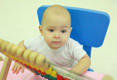 Child at a playground. Little boy with abacus. Stock Photo