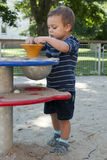Child at playground. Child playing with sand at playground on a play table equipment stock photos