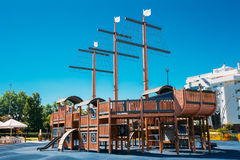 Child playground shaped old wooden pirate ship in Stock Photography