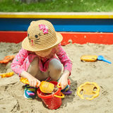 Child on playground in summer park Royalty Free Stock Photo