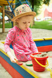 Child on playground in summer park Stock Photos