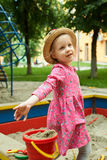 Child on playground in summer park Stock Images