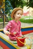 Child on playground in summer park Stock Photo