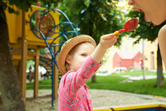 Child on playground in summer park Royalty Free Stock Image