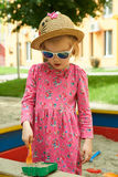 Child on playground in summer park Royalty Free Stock Photos