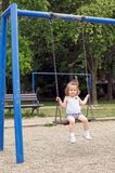 Child at playground swinging Royalty Free Stock Photo