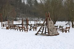 Child playground in winter natural forest park Stock Photo
