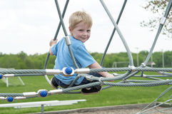 Boy playing at the park Stock Photos