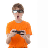 Child playing 3d video game. Child playing video game with 3D glasses Stock Photography